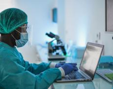 An image of a doctor working on a laptop.
