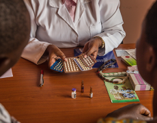 An image of a woman being offered different contraception options