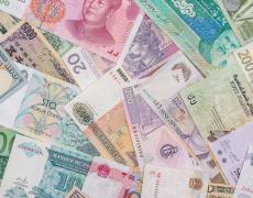 Various world currencies. Adobe Stock.