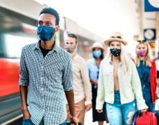 Rail passengers wearing masks