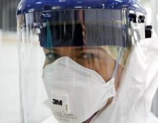 Army trainers show NHS doctors and nurses how to put on Personal Protective Equipment (PPE) that they will wear in the British-built Ebola treatment centres in Sierre Leone.