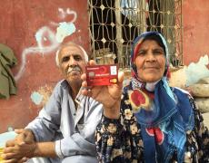 A Syrian couple proudly display their Turkish e-card