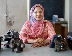 Shirina Akter with refrigeration machinery she teaches with in her classroom at UCEP school, Dhaka, Bangladesh, March 2016.