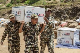 The Nepalese army unloads disaster relief supplies after the Nepal earthquake.  Photo by: Kashish Das Shrestha for USAID